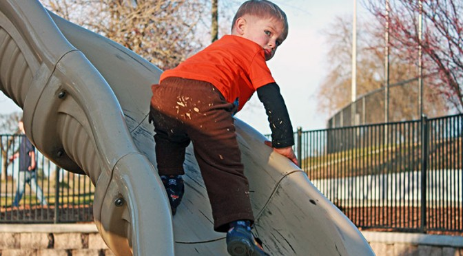 Theo climbs the slide