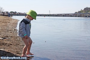 Theo wades into the lake